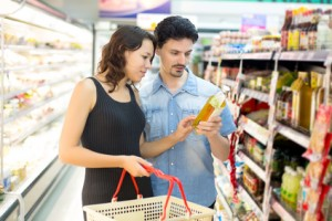 couple buys oil at the supermarket